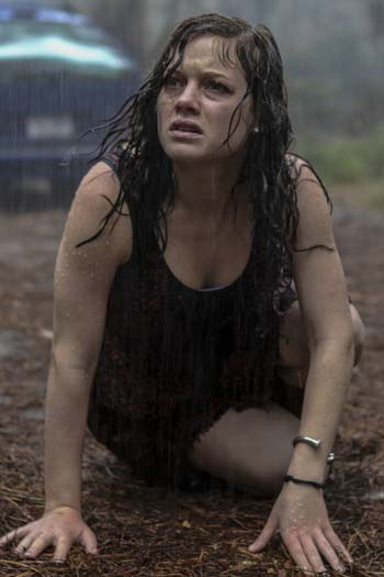 Mia in the rain as the Evil awakens - Courtesy Ghost House Pictures/FilmDistrict/TriStar Pictures